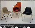 Polypropylene stacking chairs in original colours (charcoal, light grey and flame red), Robin Day, Hille, 1964.jpg