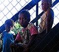 Portrait of three children in the village of Radifasu, Malaita sitting on some stairs. (10714256355).jpg