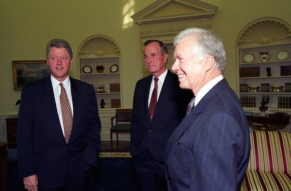President Bill Clinton meeting with former Presidents George H.W. Bush and Jimmy Carter at the White House