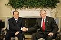 President George W. Bush shakes hands with Italian Prime Minister Silvio Berlusconi.jpg