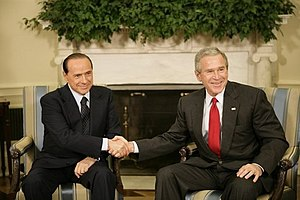 George W. Bush shakes hands with Silvio Berlusconi, during his visit to the Oval Office, Monday, 31 October 2005. White House photo by Eric Draper.