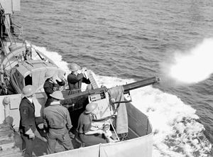 QF 2-pounder naval gun - Gunners on HMCS ''Assiniboine'' fire their 2 pdr while escorting a troop convoy from Halifax to Britain, 10 July 1940.
