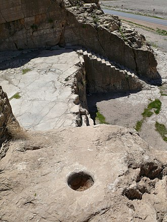 Qadamgah (ancient site) - The right-hand staircase and one of the holes (in foreground)