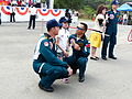 ROCA Dragon Team Crew C. H. Chang and Y. L. Pan Photoing with Girl 20140329.jpg