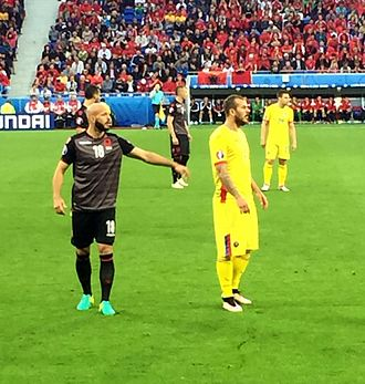 Denis Alibec - Alibec (yellow in foreground) playing for Romania at Euro 2016.