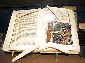 Concealment device - Radio hidden in a book. This was commonly done in World War II to hide radios from the German occupiers.
