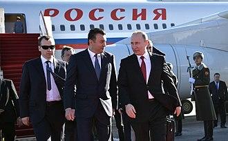 Kokhir Rasulzoda - Rasulzoda with Vladimir Putin.