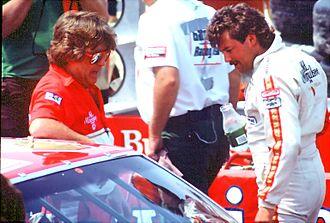 Tim Richmond - Richmond (right) talking with a crew member
