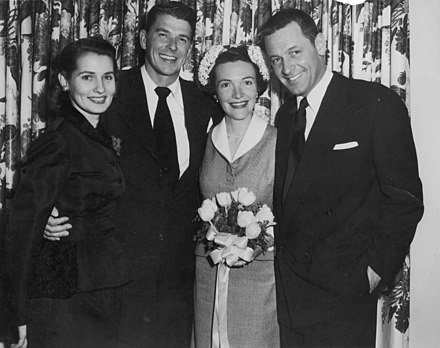 Wedding of Ronald and Nancy Reagan, 1952. Matron of honor Brenda Marshall (left) and best man William Holden (right) were the sole guests Reagan wedding - Holden - 1952.jpg