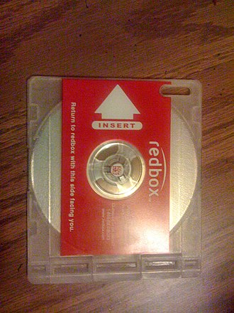 Redbox - A Redbox barcoded DVD tray, delivered by and returned to the kiosk.