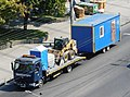 Renault flatbed truck transporting.jpg