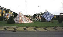 A roundabout featuring geometrical sculptures fashioned from road signs