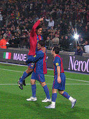 Ronaldinho celebrates a goal with Belletti and Giuly.