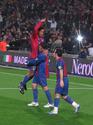 Ludovic Giuly - Giuly celebrating a goal against Real Sociedad with Ronaldinho and Juliano Belletti.