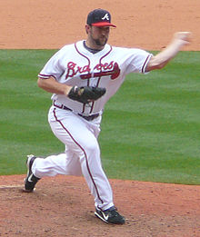 Royce Ring throwing a pitch, about to release the ball, playing for the Atlanta Braves.