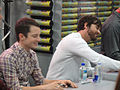 San Diego Comic-Con 2011 - Elijah Wood and Jason Gann from Wilfred sign for fans (Fox booth) (5977356232).jpg