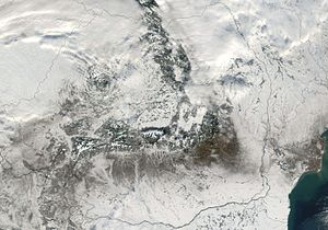 Climate of Romania - Satellite image of Romania in December, showing most of its territory under snow