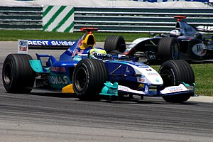 Peter Sauber - Giancarlo Fisichella driving for the Sauber Petronas Formula One team at the US Grand Prix at Indianapolis, 2004.