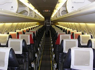 Bombardier Dash 8 - The interior of a SAS Commuter DHC-8-402 cabin in 2004