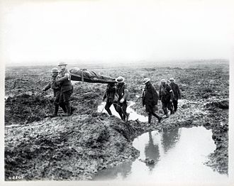 Second Battle of Passchendaele - Canadian troops carry a wounded man to the aid post.