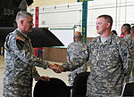 Sergeant Major of the Army Raymond F. Chandler, left, gives a coin to Sgt. Michael Tiller during Chandler's visit in the hangar of Butts Army Airfield in Fort Carson, Colo., May 15, 2013 130515-A-RI441-650.jpg