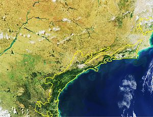 Serra do Mar coastal forests - Satellite picture of Serra do Mar coastal forests ecoregion (within yellow line). The deforestation (tan areas) of the ecoregion is visible.