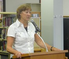 picture of Sharon Creech giving a talk at a school
