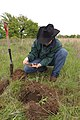 Soil scientist Nathan Haile examines soil health in well managed rangeland. (24744140609).jpg