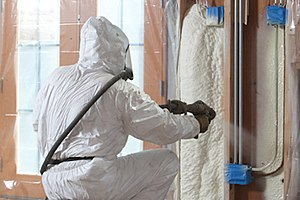Spray foam - Open cell spray polyurethane foam insulation being applied in wall cavities.