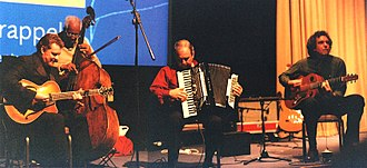 Stéphane Grappelli - Martin Taylor (left) with Coleridge Goode on double bass and John Etheridge (right) plus Jack Emblow on accordion at the launch of the Stéphane Grappelli DVD, London 2002