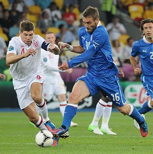 Daniele De Rossi - De Rossi (right) with Steven Gerrard of England in Italy's Euro 2012 quarter-final