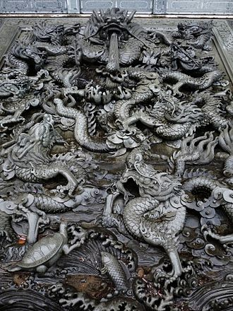 Chinese culture - Nine Dragons Stone in Imperial Temple.It was a symbol and representative for the Son of Heaven, the Mandate of Heaven, the Celestial Empire and the Chinese Tributary System during the history of China.