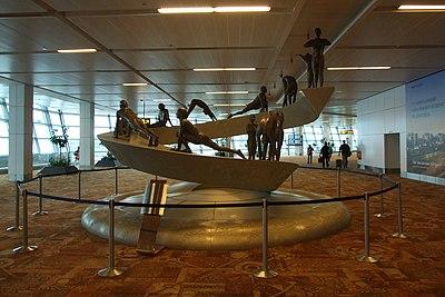 Surya Namaskar sculpture at IGIA T3.jpg