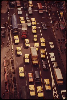 TRAFFIC IN THE HERALD SQUARE AREA OF MIDTOWN MANHATTAN NEAR INTERSECTION OF 34TH STREET AND BROADWAY. NOTE HIGH... - NARA - 549899