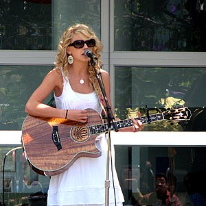 "Taylor Swift (album) - Swift performing ""Tim McGraw"" in 2007. The song was written about a breakup with a senior boyfriend because he was attending college. Country singer Tim McGraw is  one of the things he used to remember her by."