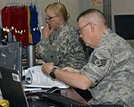 Texas State Guard Army Sgt. Susan Simmons and Air Staff Sgt. Jack Lambert work in the plans section.jpg