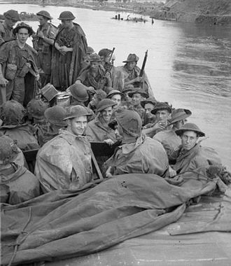 7th Indian Infantry Division - Men of the 1st Battalion, Queen's Royal Regiment (West Surrey), on patrol aboard an assault boat on the Pegu Canal near Waw, July 1945.