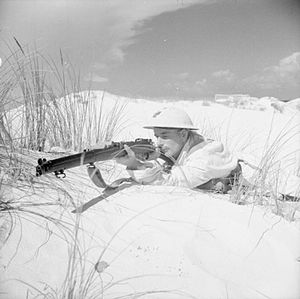 South Staffordshire Regiment - A rifleman of the 1st Battalion, South Staffordshire Regiment wearing a light-coloured oversuit for camouflage against the dunes during training at Mersa Matruh, 25 October 1940.