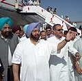 The Chief Minister of Punjab Capt. Amrinder Singh guiding the Minister for Civil Aviation Shri Praful Patel to the lounge, after receiving him at the tarmac at Raja Sansi Airport at Amritsar on May 15, 2005.jpg