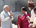 The Prime Minister, Shri Narendra Modi being received by the Chief Minister of Rajasthan, Smt. Vasundhara Raje, on his arrival, at Jhunjhunu, Rajasthan on March 08, 2018.jpg