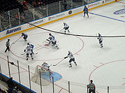 The Thrashers take the puck into the offensive zone against the St. Louis Blues at Philips Arena on September 22, 2007