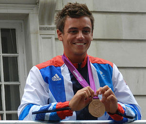 Tom Daley - Daley holding his individual Olympic bronze medal at the Olympic Victory Parade