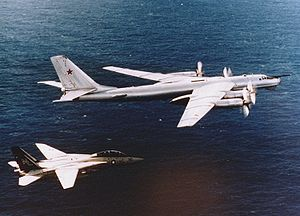 Military aviation - An American F-14 fighter intercepting a Russian Tu-95 long range nuclear bomber