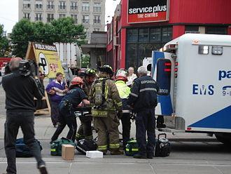 Toronto Paramedic Services - Paramedics prepare to transport patient.