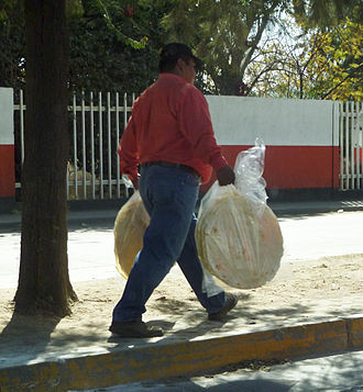 Corn tortilla - Toasted tortillas are used for making tlayudas being sold by a street vendor in Oaxaca