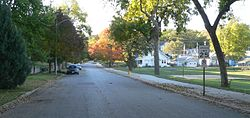 Street with trees on left, small park on right
