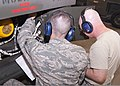 U.S. Air Force Airman 1st Class David Morse, left, and Staff Sgt. Daniel Kristiansen, both with the 361st Training Squadron, check an instruction manual to troubleshoot an electrical problem June 8, 2011, at 110608-F-NS900-024.jpg