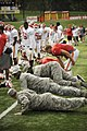 U.S. Air Force Airmen from Whiteman Air Force Base, Mo., do push-ups with kickers of the Kansas City Chiefs (6060194214).jpg