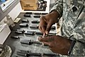 U.S. Army Spc. Immanuel Jones, a range safety officer, loads M9 Beretta pistol magazines for Soldiers with the Joint Staff Army Reserve Element on the firing range at Camp Allen, Va., Aug. 5, 2012 120805-A-GX923-018.jpg