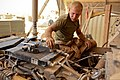 U.S. Marine Corps Lance Cpl. Daniel Korb, a motor transport mechanic with 3rd Battalion, 2nd Marine Regiment, works on a mine-resistant, ambush-protected vehicle at Forward Operating Base Edinburgh, Afghanistan 110707-M-PE262-001.jpg